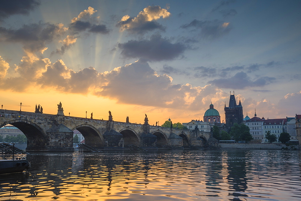 Colourful sunrise over the Charles Bridge with the Old Town Tower and Stare Mesto, UNESCO World Heritage Site, Prague, Czech Republic, Europe - 1241-141