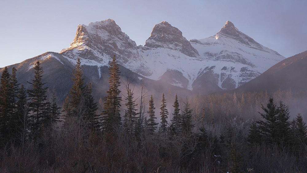 The Peaks of Three Sisters at sunrise in winter with mountain mist, Canmore, Alberta, Canadian Rockies, Canada, North America - 1241-164