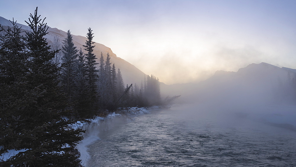 Mist rising off the waters of the Bow River in sub-zero winter weather, Canmore, Alberta, Canadian Rockies, Canada, North America - 1241-165