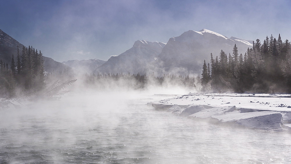 Mist rising off the waters of the Bow River in sub-zero winter weather, Canmore, Alberta, Canadian Rockies