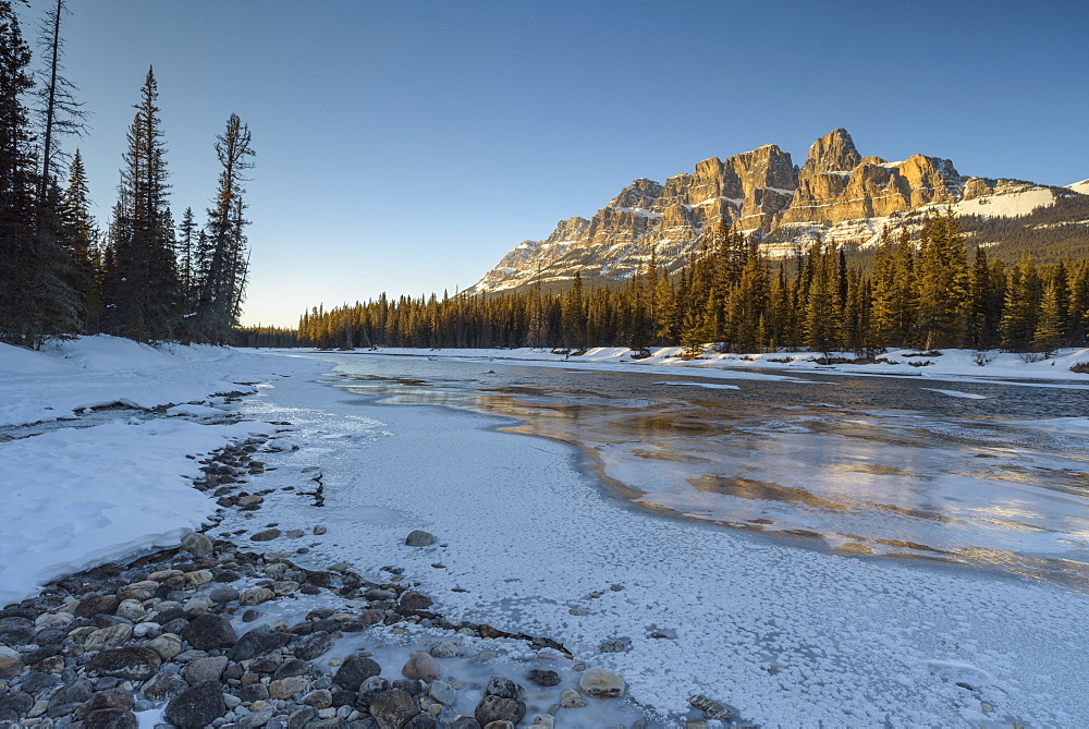 Sunset at Castle Mountain with frozen Bow River in winter, Banff National Park, Alberta, Canadian Rockies