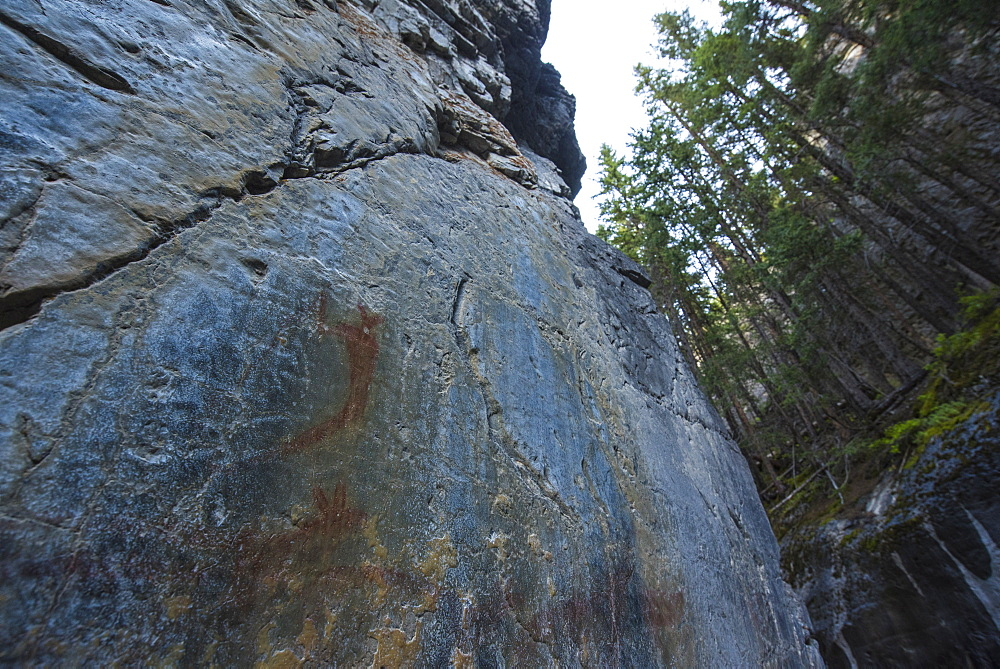 Ancient Indigenous pictographs on a canyon wall, Grotto Canyon, Alberta, Canada
