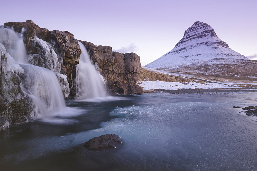 Sunrise at Kirkjufellsfoss and Kirkjufell Mountain, Snaefellsnes Peninsula, Iceland, Polar Regions