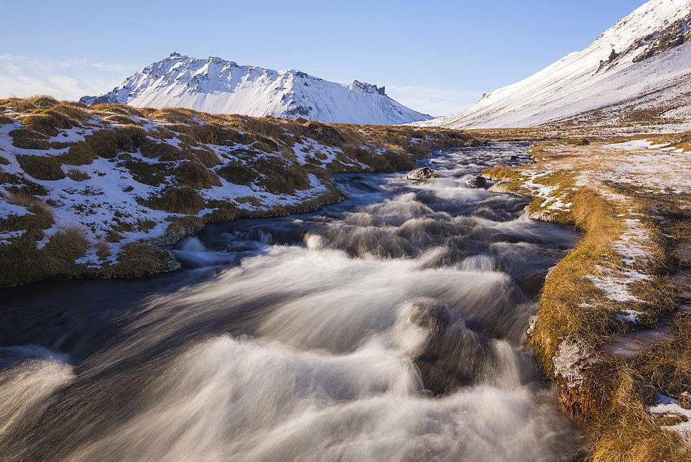 Glacial River and snow-capped mountains, Snaefellsnes, Iceland