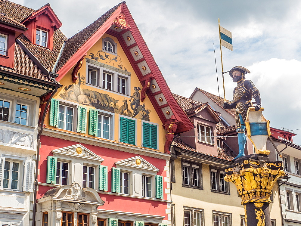 Colorful historic buildings and statue, Zug, Switzerland, Europe