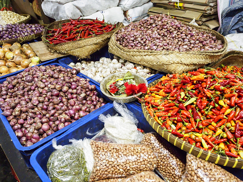 Colourful produce of peppers, garlic, onions, peanuts and shallots, at a market in Denpasar, Bali, Indonesia, Southeast Asia, Asia