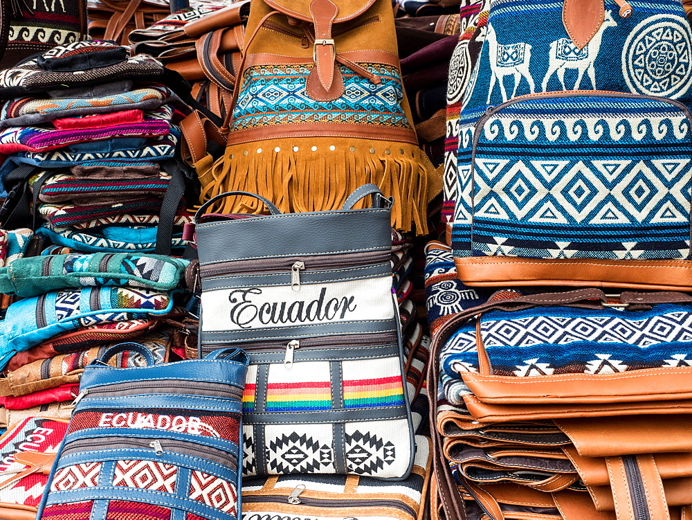 Tourist goods for sale, craft market, Plaza de los Ponchos, Otavalo, Ecuador, South America