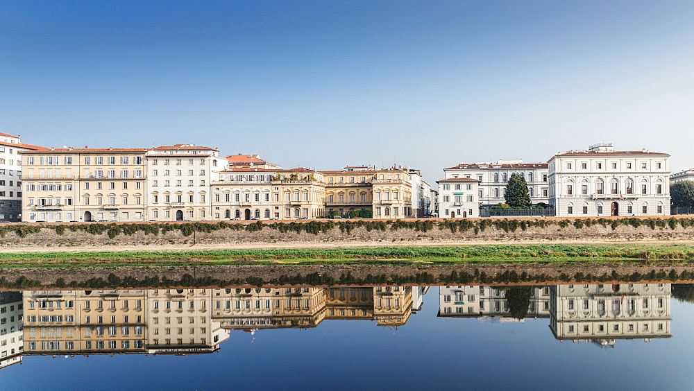 Reflection of buildings on River Arno, Florence, Tuscany, Italy