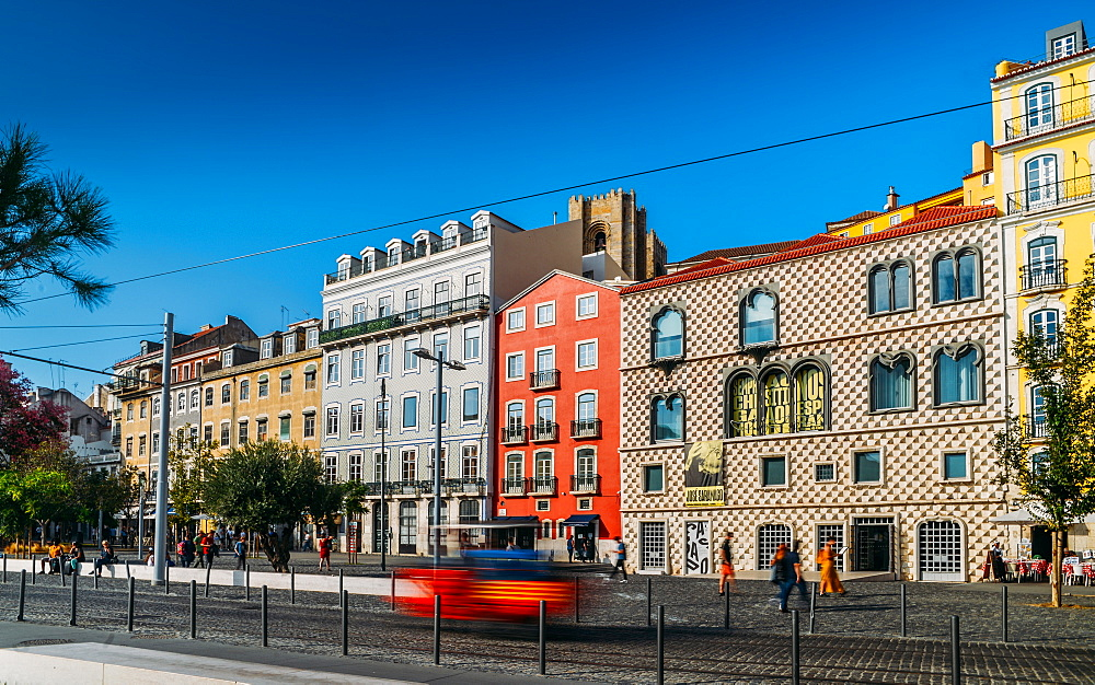 Traditional buildings with azulejo tiles in the old Lisbon neighbourhood of Alfama with Se Cathedral in background, Lisbon, Portugal, Europe - 1243-354