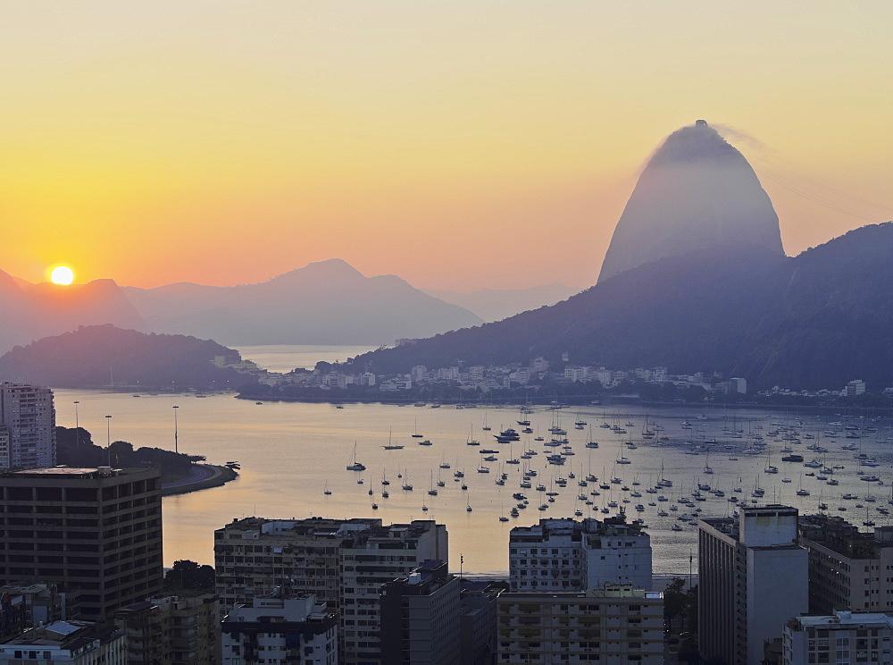 Brazil, City of Rio de Janeiro, View over Botafogo Neighbourhood towards the Sugarloaf Mountain at sunrise.