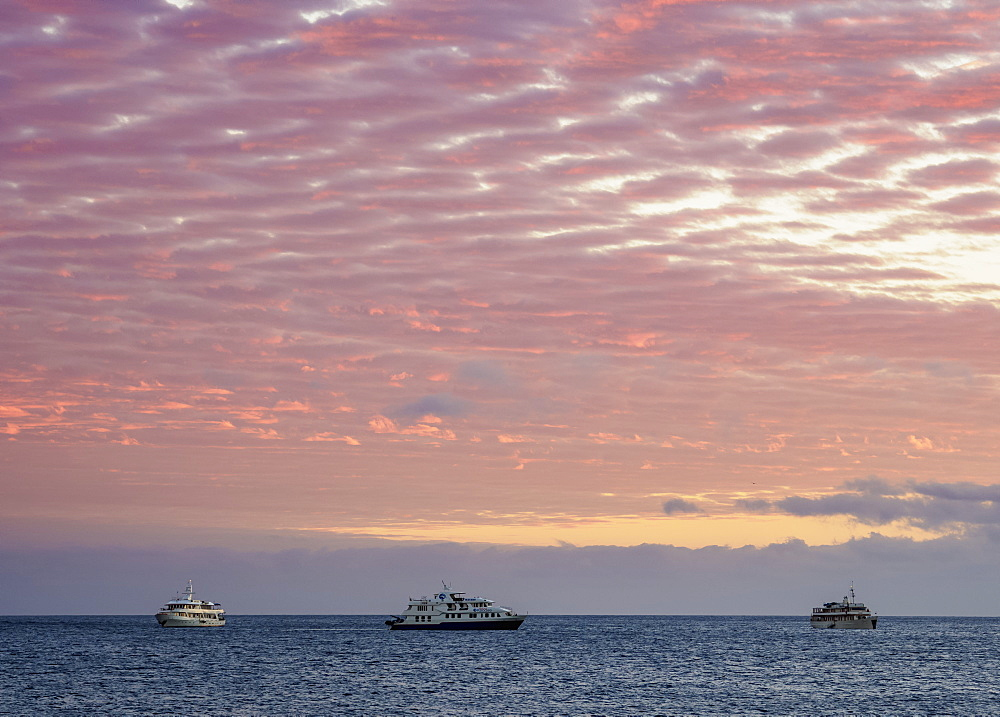 Cruise ships off Bartolome Island at sunrise, Galapagos, UNESCO World Heritage Site, Ecuador, South America