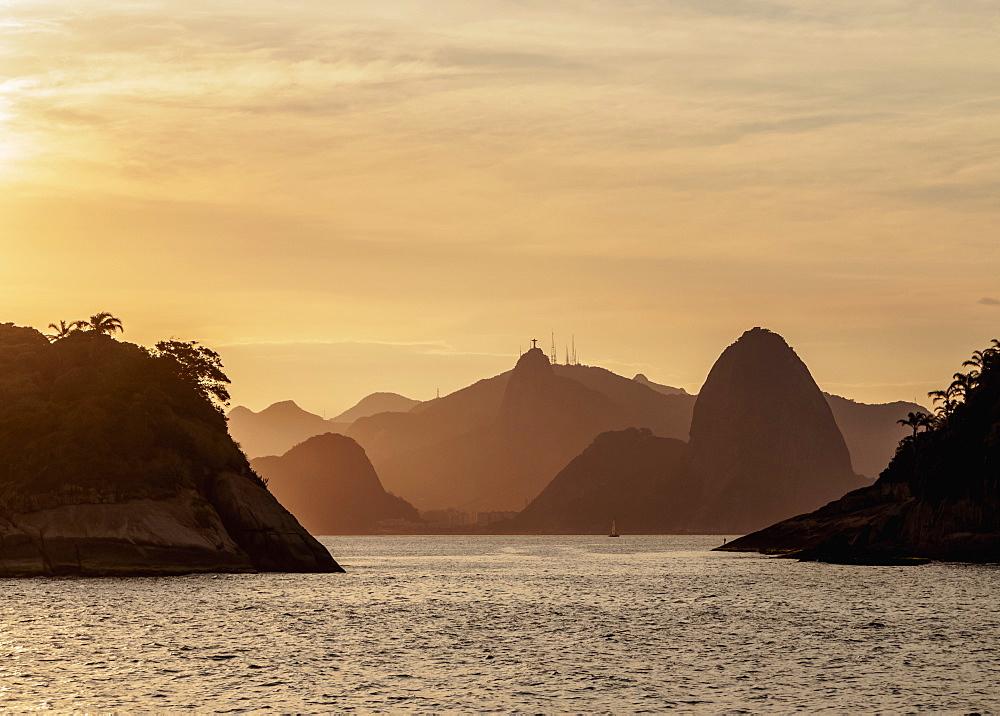 View over rocks of Piratininga towards Rio de Janeiro, sunset, Niteroi, State of Rio de Janeiro, Brazil, South America