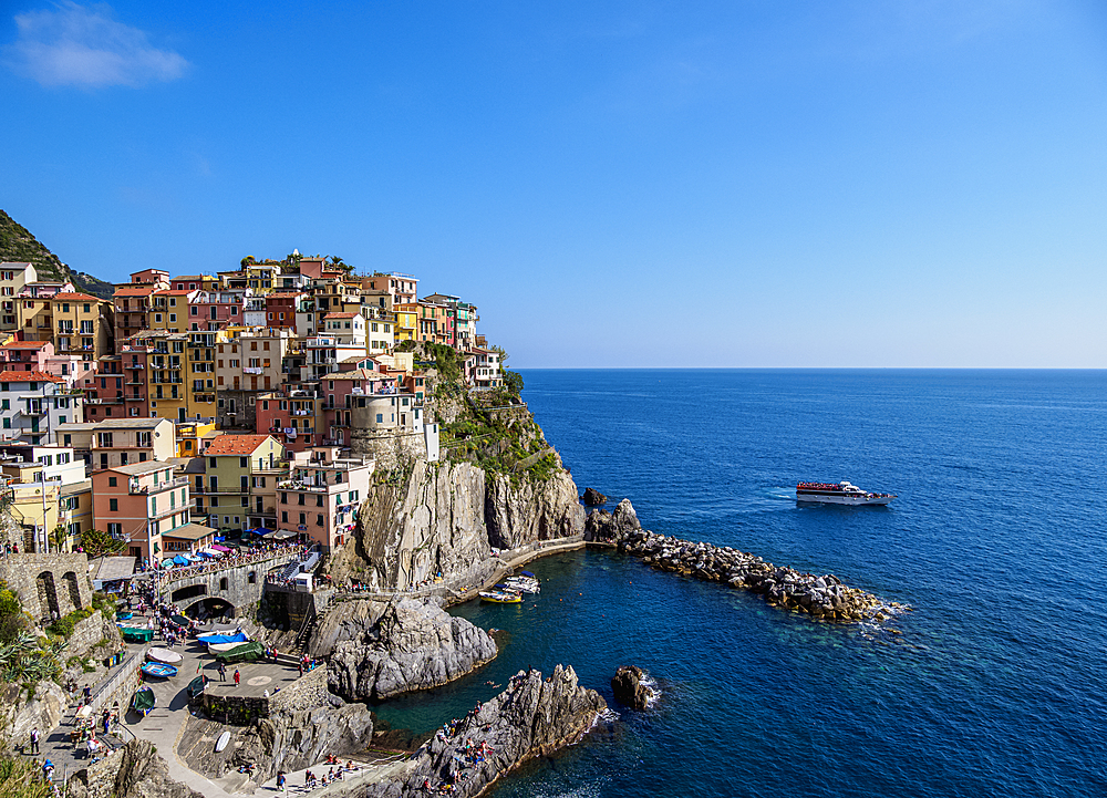 Ferry on the coast of Manarola Village, elevated view, Cinque Terre, UNESCO World Heritage Site, Liguria, Italy, Europe