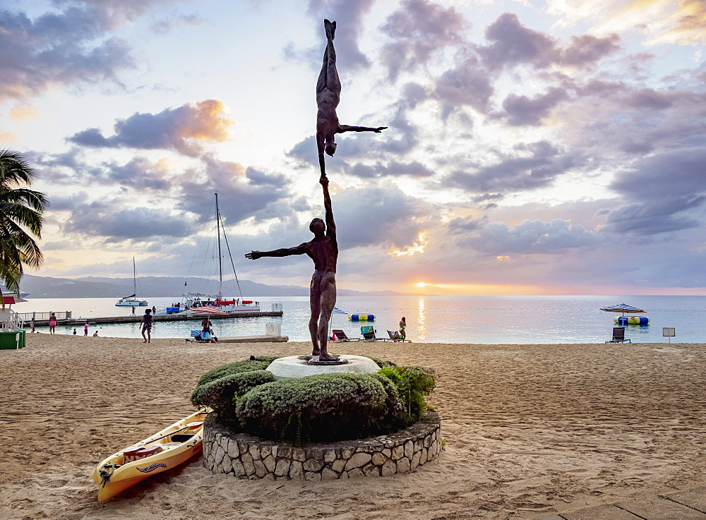Statue Balance by Basil Watson at sunset, Doctor's Cave Beach, Montego Bay, Saint James Parish, Jamaica, West Indies, Caribbean, Central America