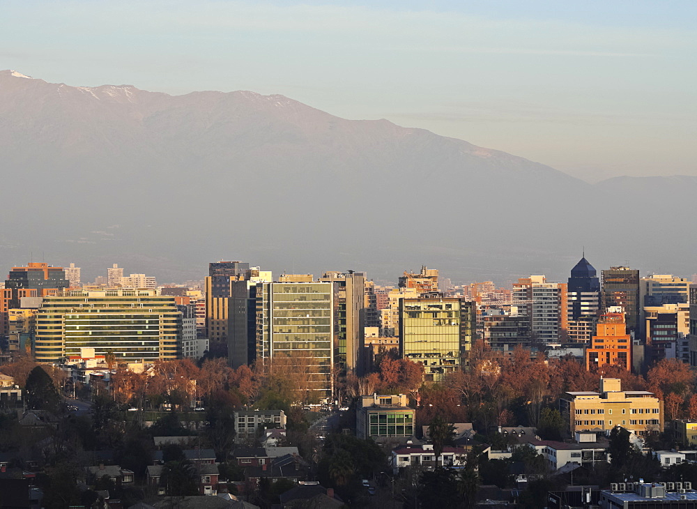 Chile, Santiago, View from the Parque Metropolitano towards the high raised buildings in financial sector. Snow covered Andes in