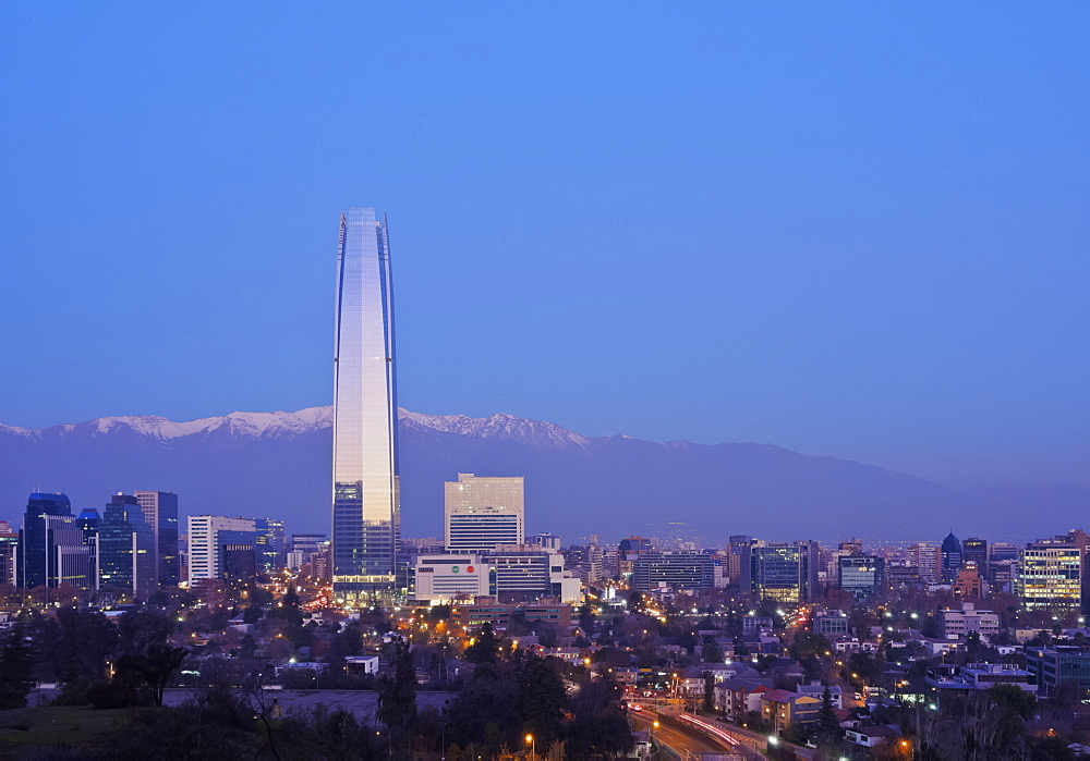 Twilight view from the Parque Metropolitano towards the high rise buildings and Costanera Center Tower, Santiago, Chile, South America