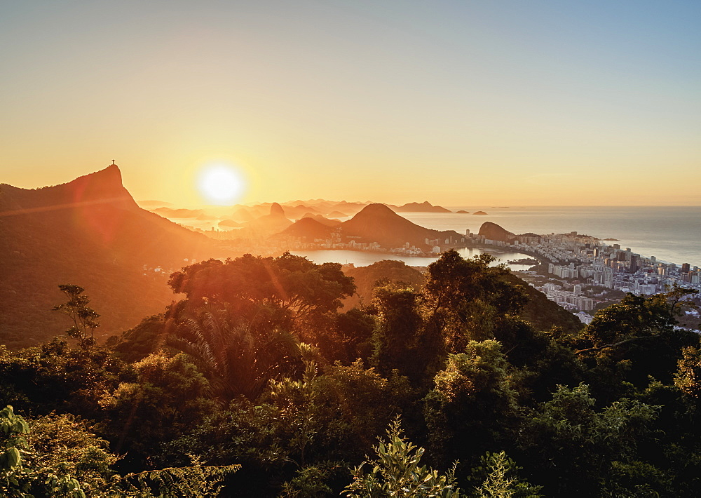 View from Vista Chinesa over Tijuca Forest towards Rio de Janeiro at sunrise, Brazil