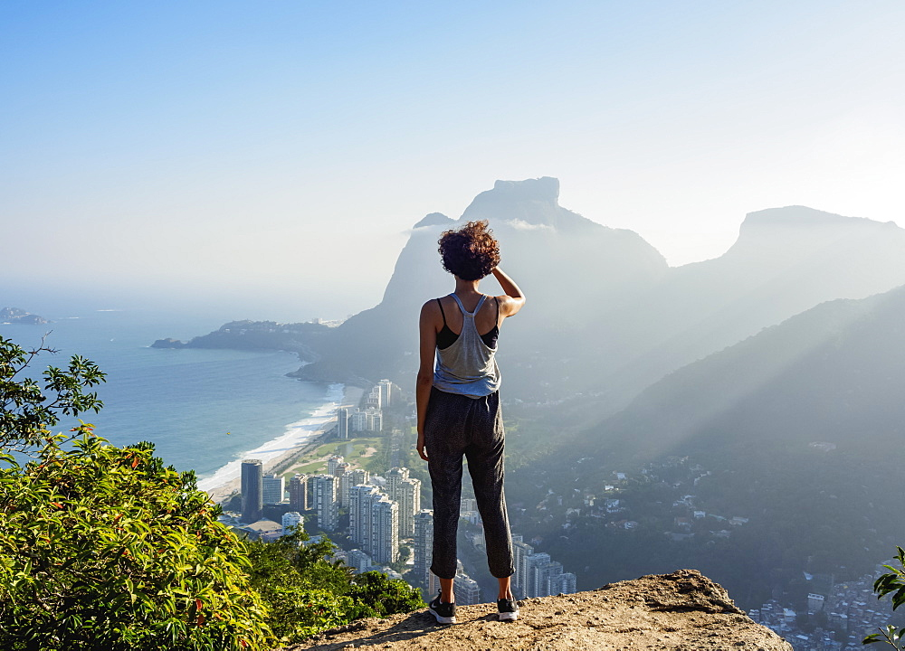 Brazilian girl looking towards the Pedra da Gavea and Sao Conrado from Dois Irmaos Mountain, Rio de Janeiro, Brazil, South America