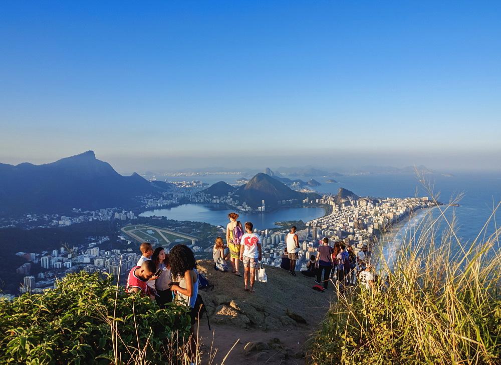 People on top of the Dois Irmaos Mountain, Rio de Janeiro, Brazil