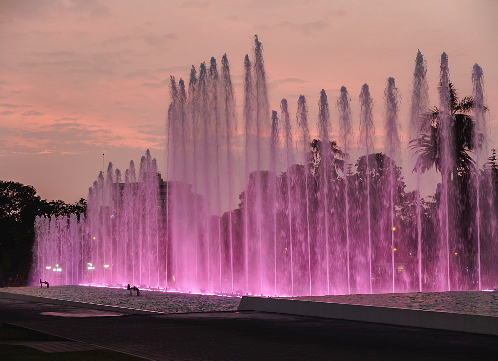 Magic Water Circuit in La Reserva Park, sunset, Lima, Peru, South America
