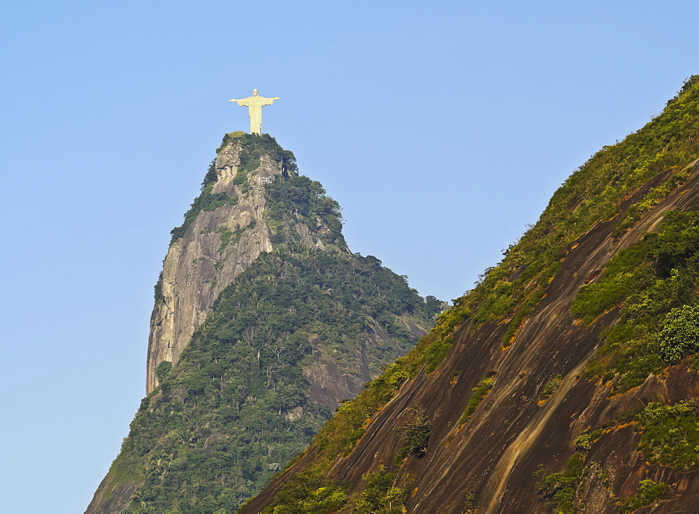Christ the Redeemer statue on top of the Corcovado Mountain viewed from Santa Marta, Rio de Janeiro, Brazil, South America