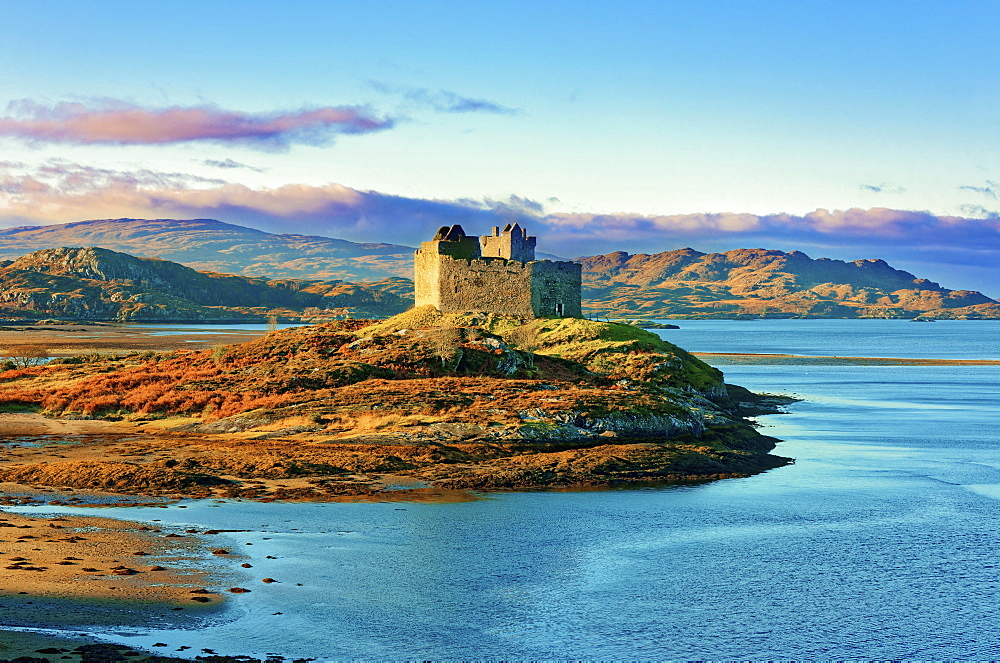 Castle Tioram on the coastal island Eilean Tioram where River Shiel and Loch Moidart meet, at low tide on a sunny winter morning, Highlands, Scotland, United Kingdom, Europe