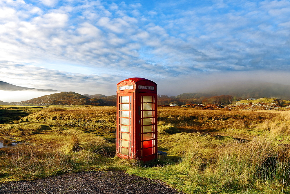Autumn view of a red telephone box at the side of a quiet road in the remote misty Ardnamurchan moors of the Scottish Highlands, Scotland, United Kingdom, Europe - 1246-17