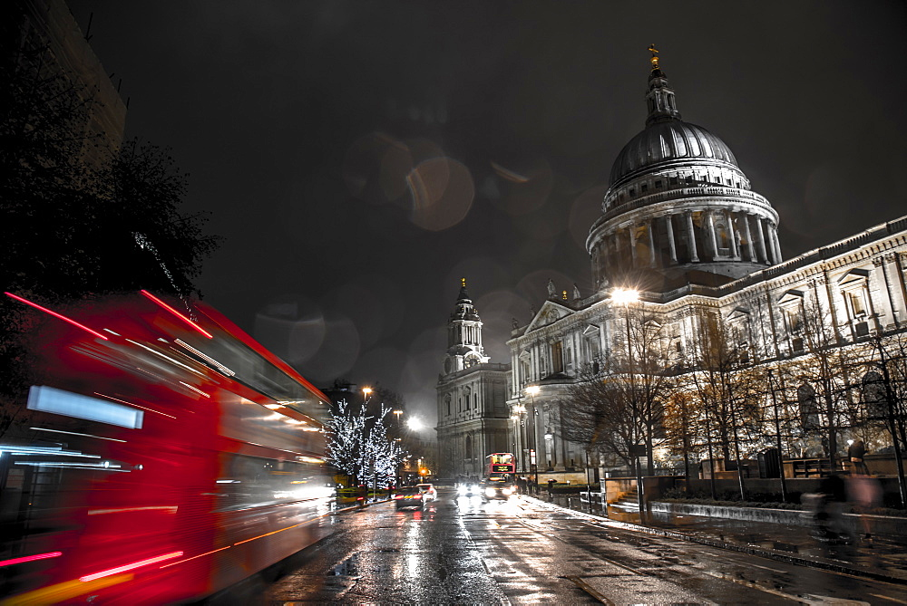 A London bus drives past St. Paul's Cathedral towards Christmas lights, London, England, United Kingdom, Europe