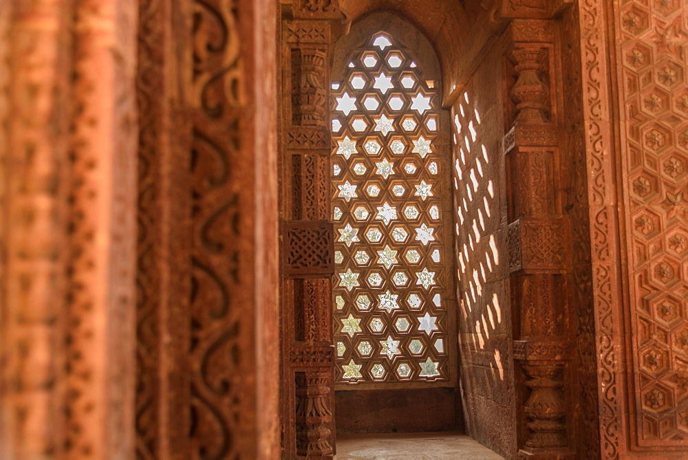 The intricate window carvings provide beautiful shadows at Qutub Minar, UNESCO World Heritage Site, New Delhi, India, Asia
