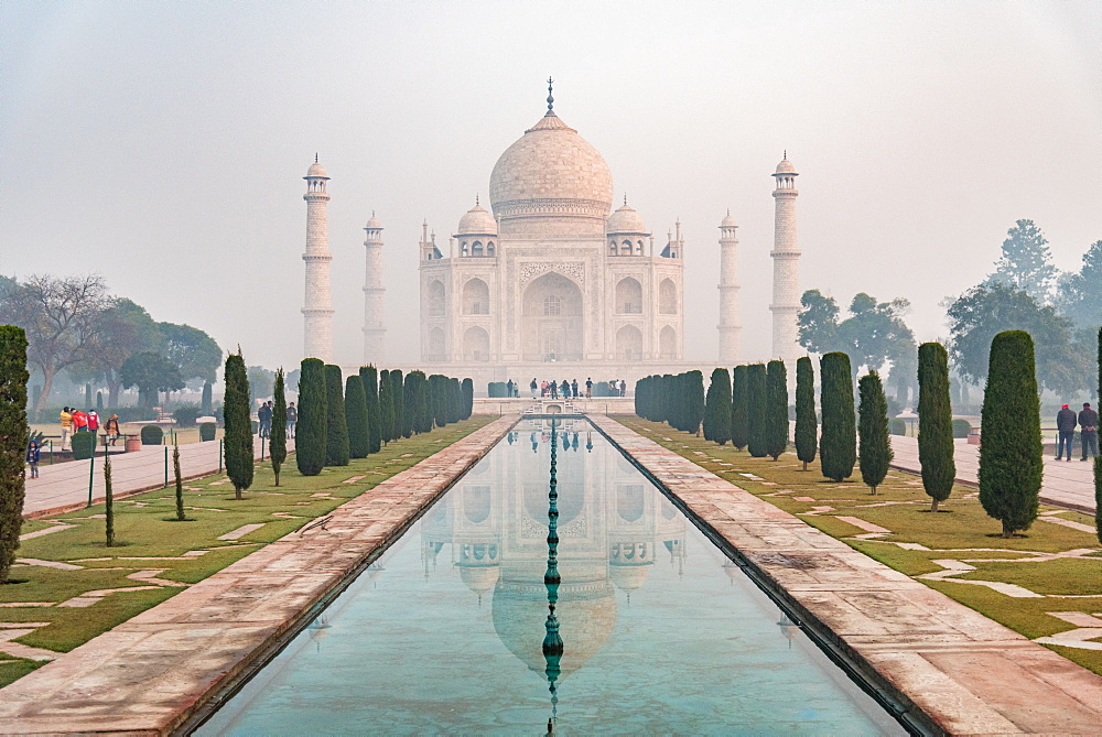 Taj Mahal reflections on a misty morning, UNESCO World Heritage Site, Agra, Uttar Pradesh, India, Asia