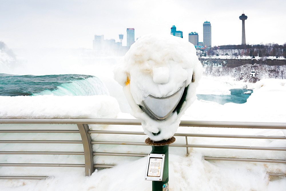 Frozen Smile. Coin operated binoculars are covered in Ice at Niagara Falls, Buffalo, New York, USA