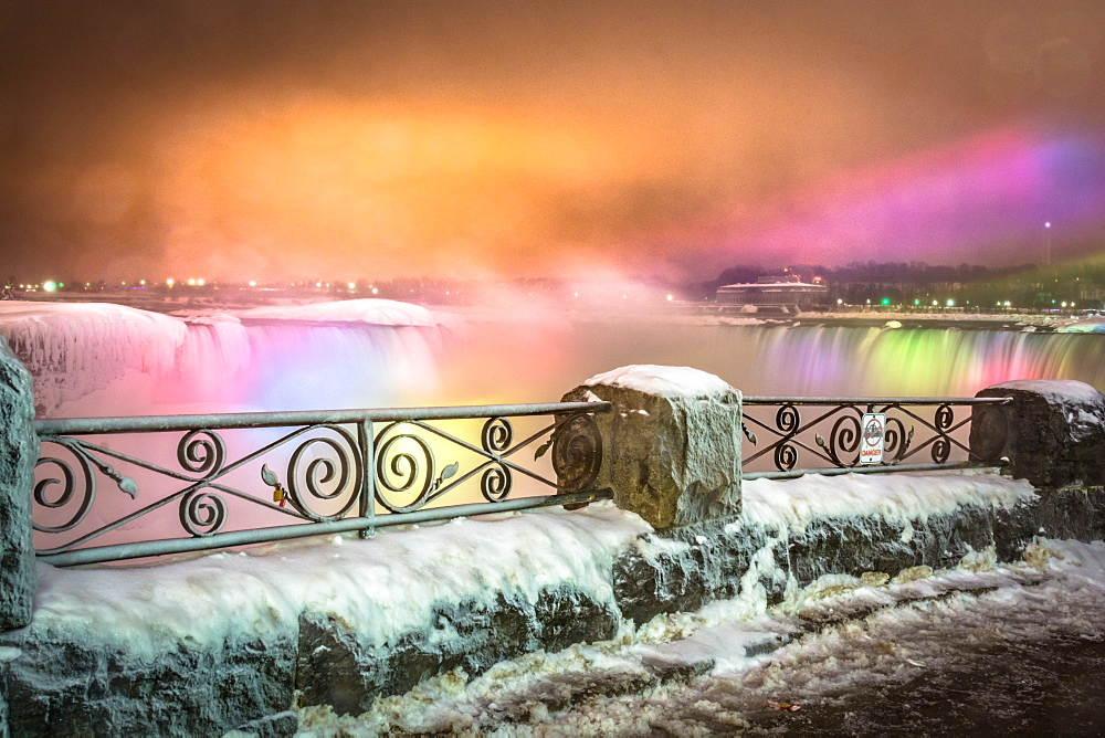 Frozen Niagara Falls in March illuminated at night, Niagara, Ontario, Canada, North America - 1247-187