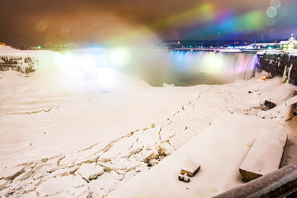 Frozen Niagara Falls in March illuminated at night, Niagara, Ontario, Canada, North America