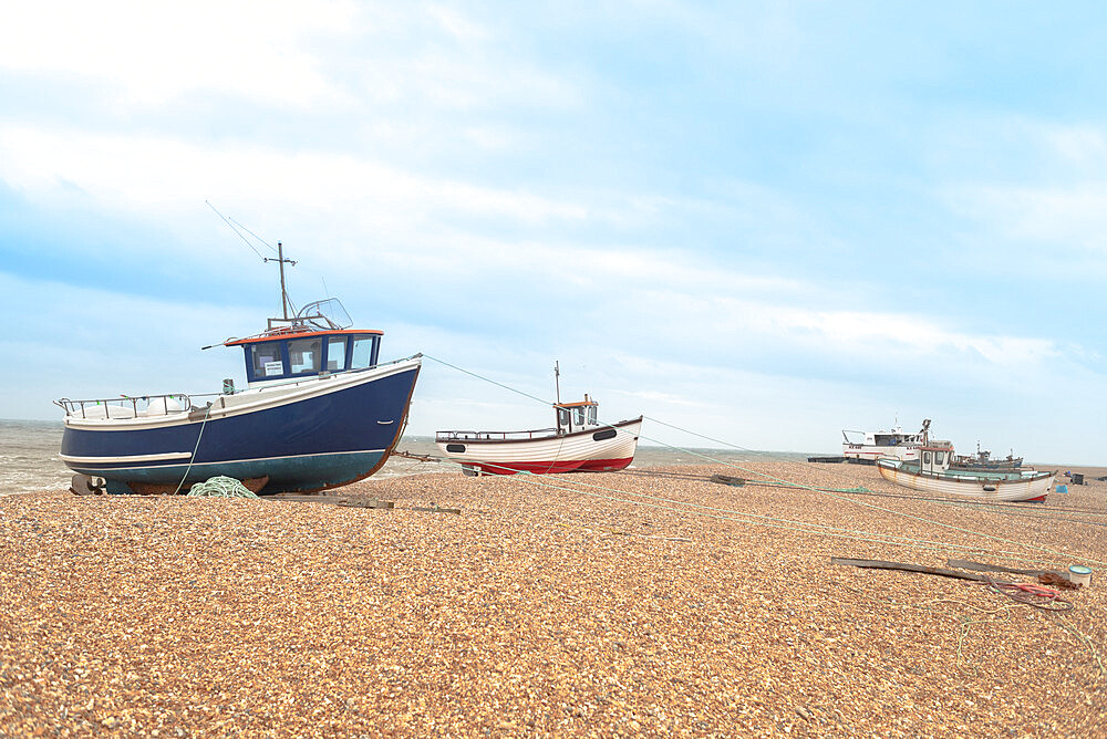 March 2019, Dungeness, Kent, England, Fishing boats sit on the shingle beach waiting to go back out to the water