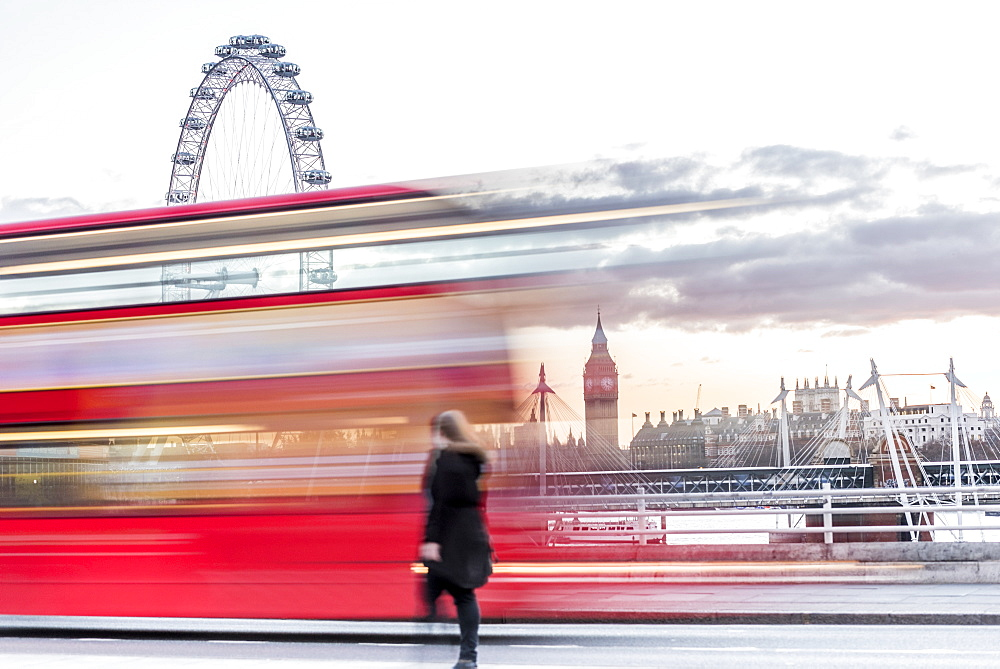 A lady crossing Waterloo Bridge with a bus passing between her, the London Eye and Big Ben, London, England, United Kingdom, Europe - 1247-34