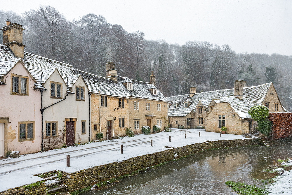 Snow covered houses by By Brook in Castle Combe, Wiltshire, England, United Kingdom, Europe - 1247-48