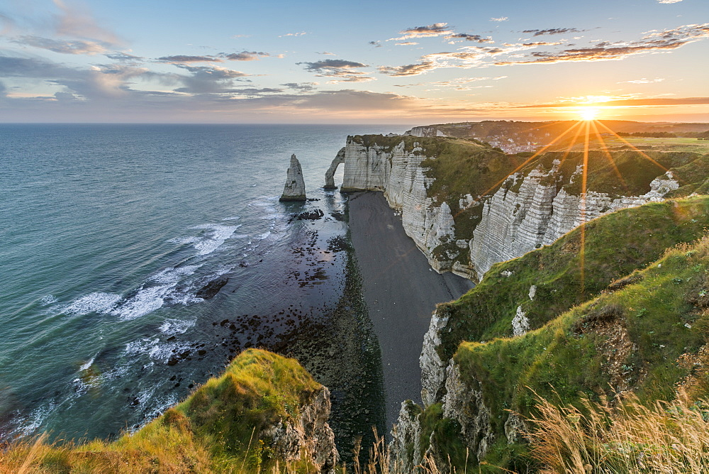 Sunrrays at dawn at the cliffs, Etretat, Normandy, France, Europe