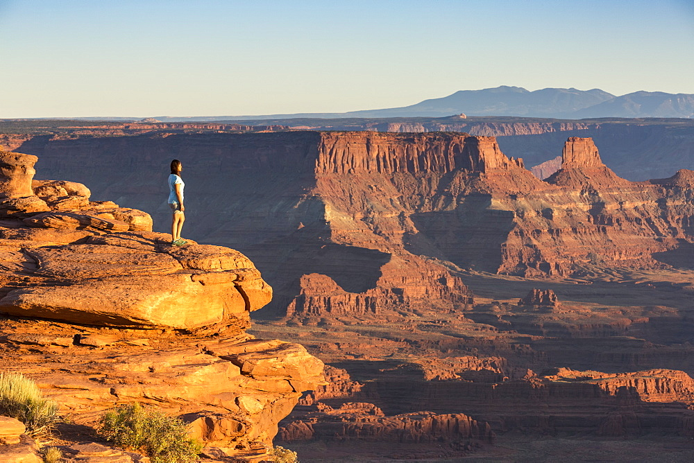 Girl admiring the landscape. Dead Horse Point State Park, Moab, Utah, USA.