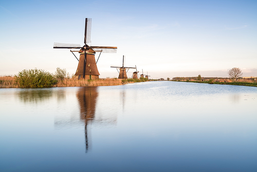 Windmills in a row on the canal. Kinderdijk, Molenwaard municipality, South Holland province, Netherlands.