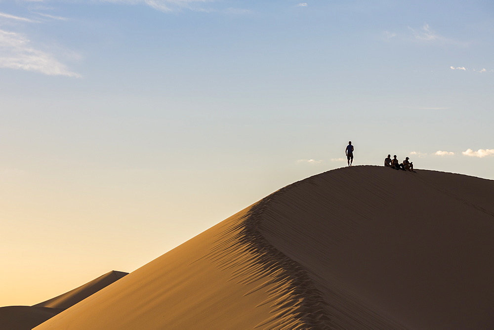 People in silhouette on Khongor sand dunes in Gobi Gurvan Saikhan National Park, Sevrei district, South Gobi province, Mongolia, Central Asia, Asia
