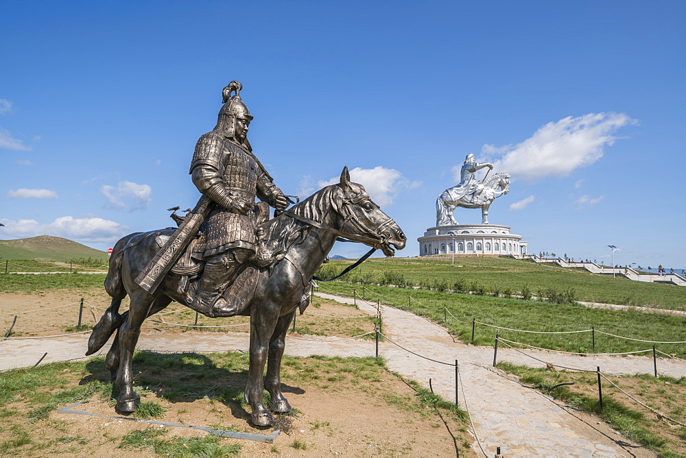 Statue of a Mongolian Empire warrior and Genghis Khan Statue Complex in the background, Erdene, Tov province, Mongolia, Central Asia, Asia
