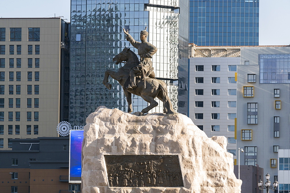 Damdin Sukhbaatar statue with skyscrapers in the background. Ulan Bator, Mongolia.