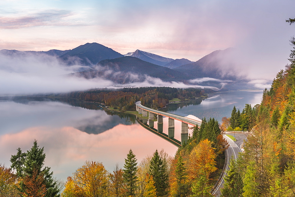 Sylvenstein Lake and bridge surrounded by the morning mist at dawn, Bad Tolz-Wolfratshausen district, Bavaria, Germany, Europe - 1251-388