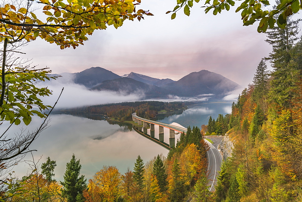 Sylvenstein Lake and bridge surrounded by the morning mist at dawn, Bad Tolz-Wolfratshausen district, Bavaria, Germany, Europe - 1251-389