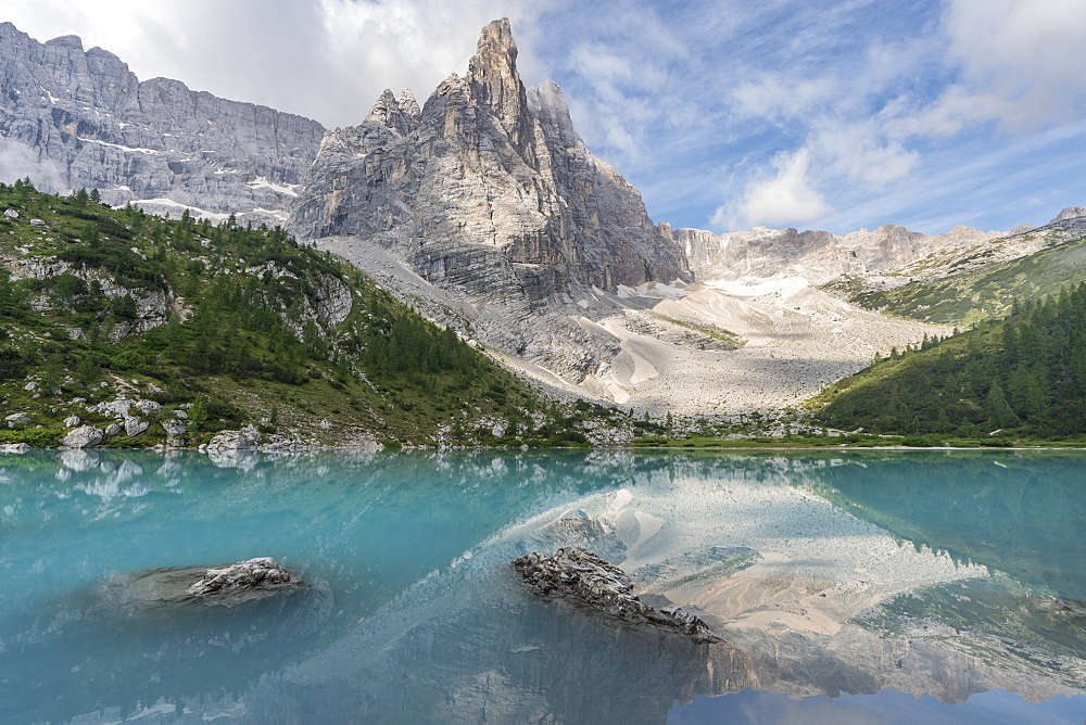 Sorapis Group with clouds and Sorapis Lake in summer. Cortina d'Ampezzo, Belluno province, Veneto, Italy.