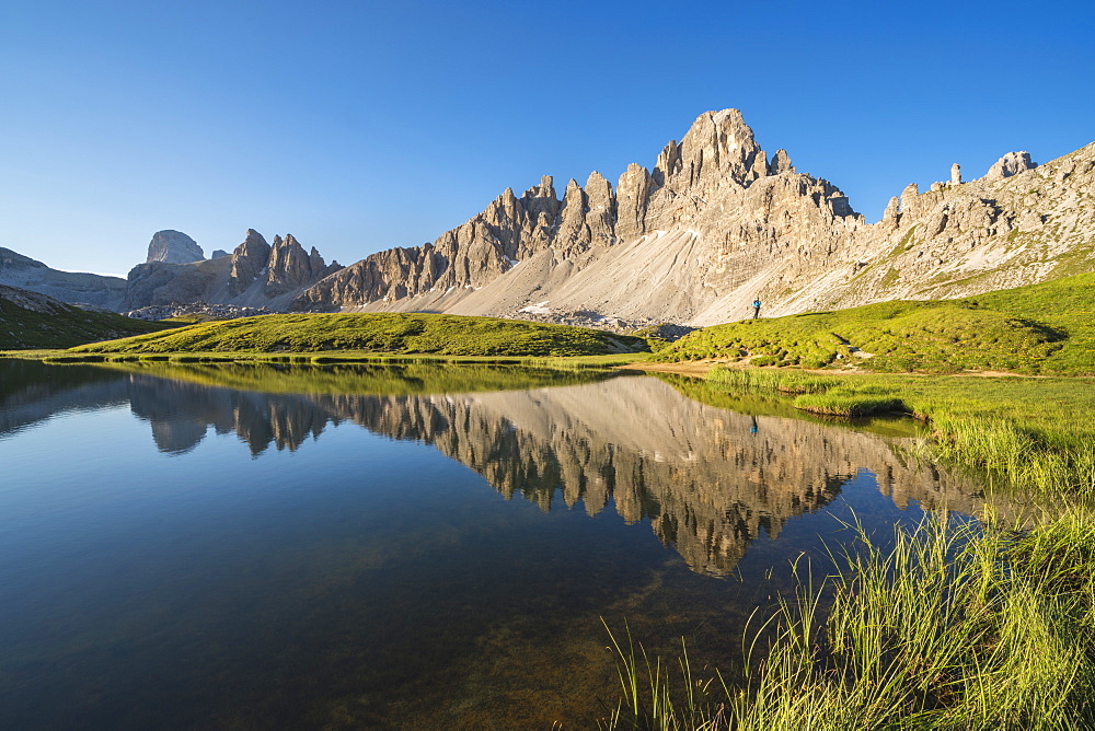 Reflection of Mount Paterno, Croda dei Piani and Croda di Toni on Piani Lakes in summer. Sesto Dolomites, Trentino Alto Adige, Italy.