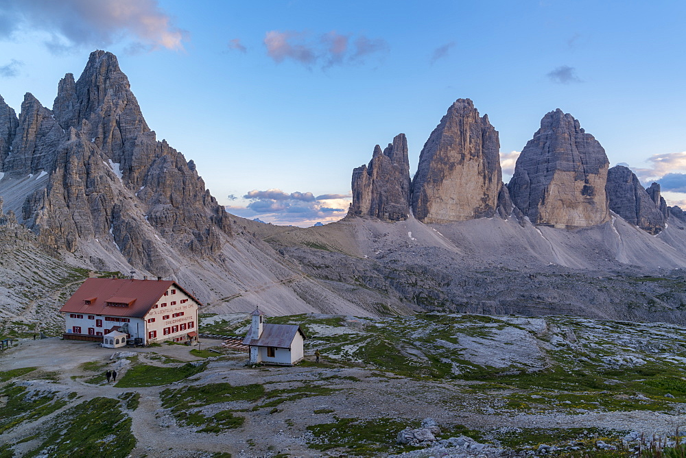 Locatelli hut with Mount Paterno and Three Peaks of Lavaredo at sunset in summer. Sesto Dolomites, Trentino Alto Adige, Italy.