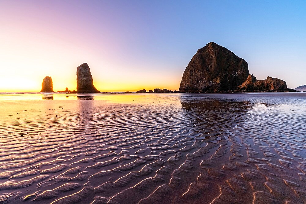 Haystack Rock and The Needles at sunset, with textured sand in the foreground, Cannon Beach, Clatsop county, Oregon, United States of America, North America - 1251-561