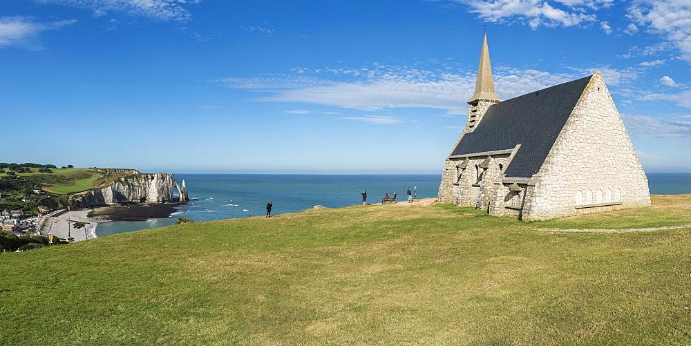 Notre-Dame de la Garde chapel and Porte d'Aval in the background, Etretat, Normandy, France, Europe