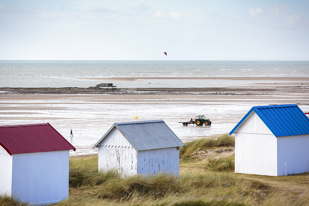 Beach huts and tractor for oyster breeding. Gouville-sur-Mer, Normandy, France.